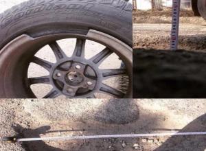 Огромная яма на Серова стала причиной поломки очередного автомобиля в Ставрополе