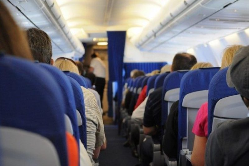airplane_on_board_seats_people_travel_transportation_aisle-745740-700x465-676x450.jpg